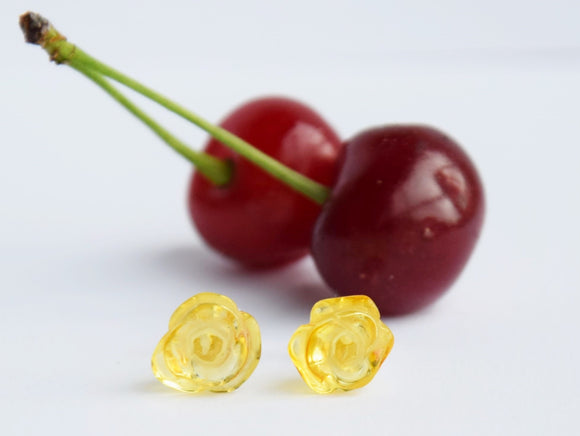Baltic amber stud earrings in shape of roses, light yellow amber, amber flowers