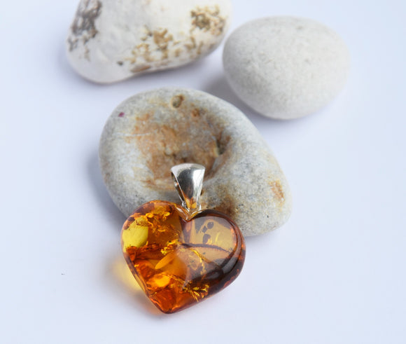 Genuine Baltic amber heart pendant, sterling silver bail, amber with inclusions