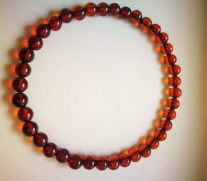 Beaded elastic amber bracelet, 6 mm beads,  transparent cognac color, genuine baltic amber - UAB Amber