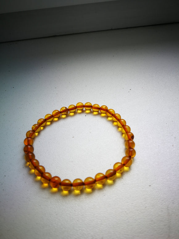 Beaded amber bracelet, 6 mm.transparent honey color beads,natural baltic amber, elastic - UAB Amber