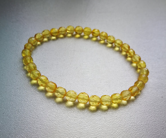 Natural baltic amber bracelet, faceted round beads, honey transparent amber, elastic bracelet - UAB Amber
