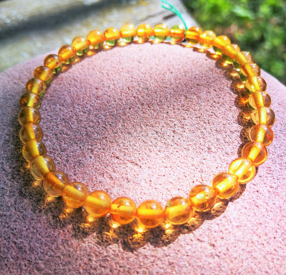 Tiny Baltic amber bracelet, round beads 5 mm,honey transparent  natural amber, elastic - UAB Amber