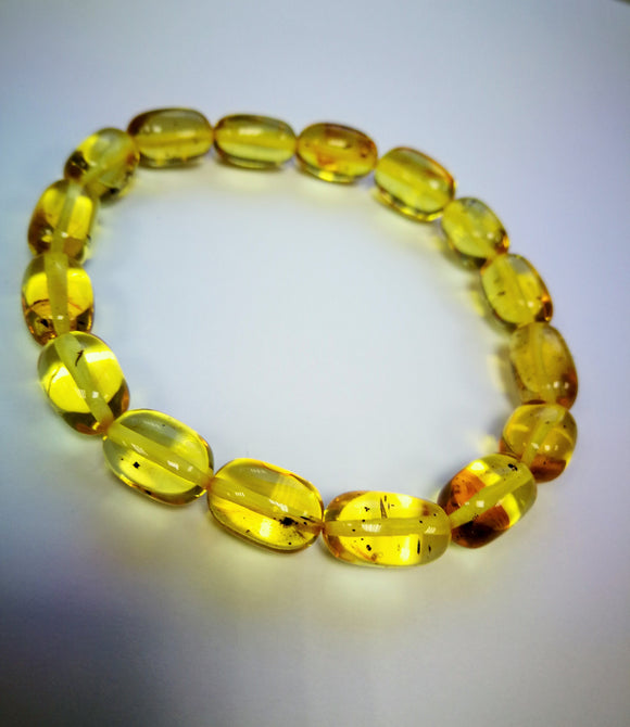 Honey transparent amber bracelet, flora inclusions, untreated olive beads, elastic, unisex