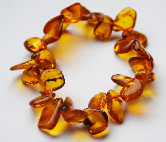 Baltic amber bracelet, elastic, ,cognac amber,,amber leaves,teardrop beads,polished amber, gemstone bracelet