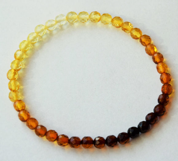 Faceted multicolor amber bracelet, round faceted beads, elastic, unisex - UAB Amber
