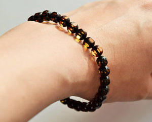 Natural Baltic amber bracelet, round faceted  beads, elastic, green amber - UAB Amber