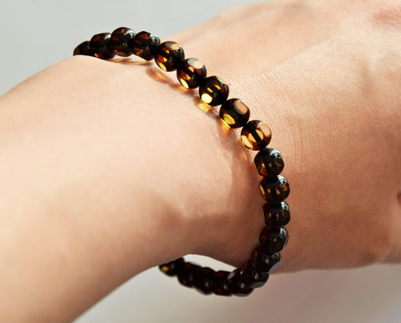 Bracelet, natural Baltic amber, faceted beads, elastic - UAB Amber