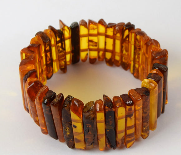 Chunky amber bracelet with flora inclusions, tube beads