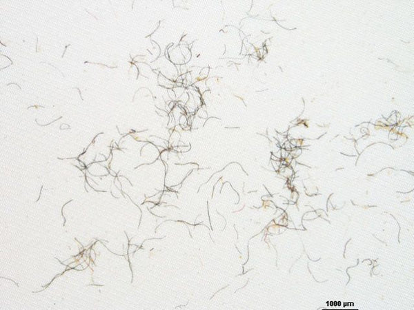 Synthetic microfibers from textiles