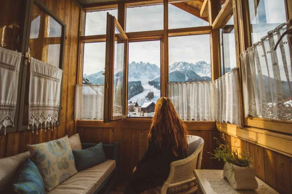 Woman looking out of a cabin window