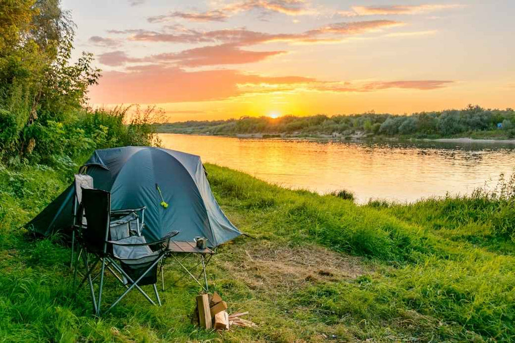 Camping tent in front of a lake