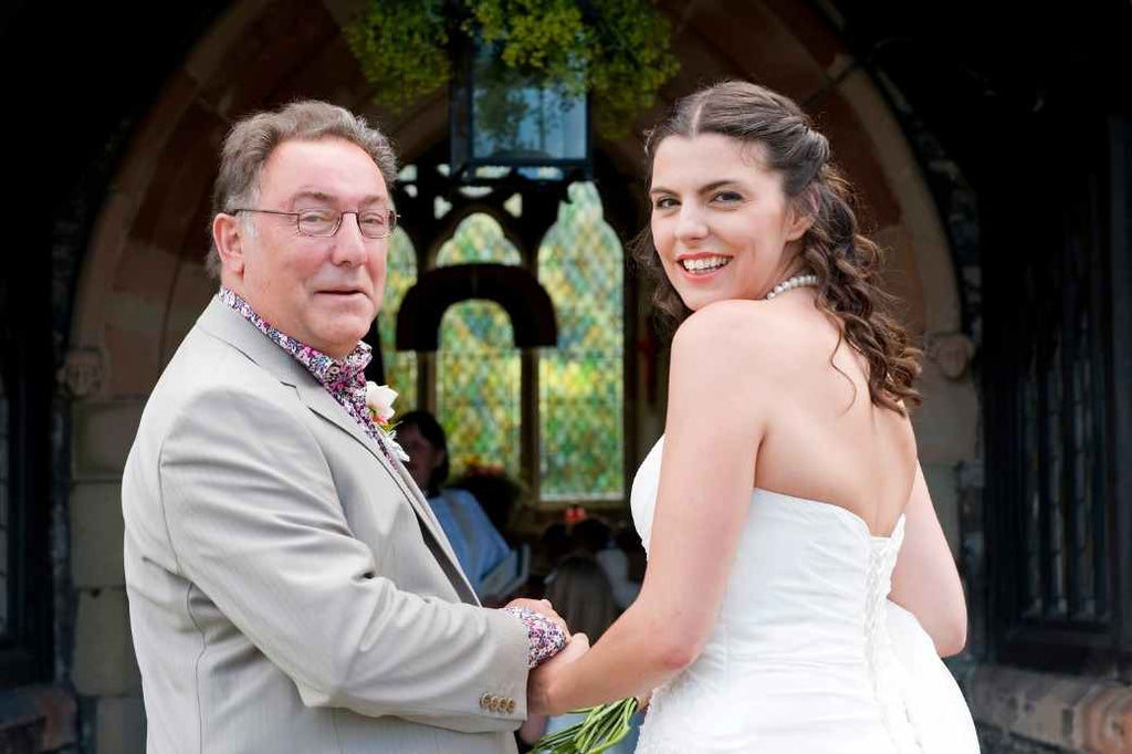 Bride and father posing for a photo