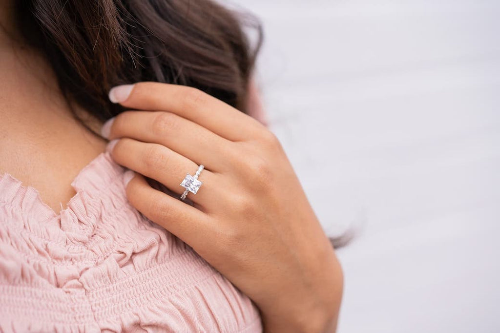 Woman in pink wearing The Alexandria on her ring finger