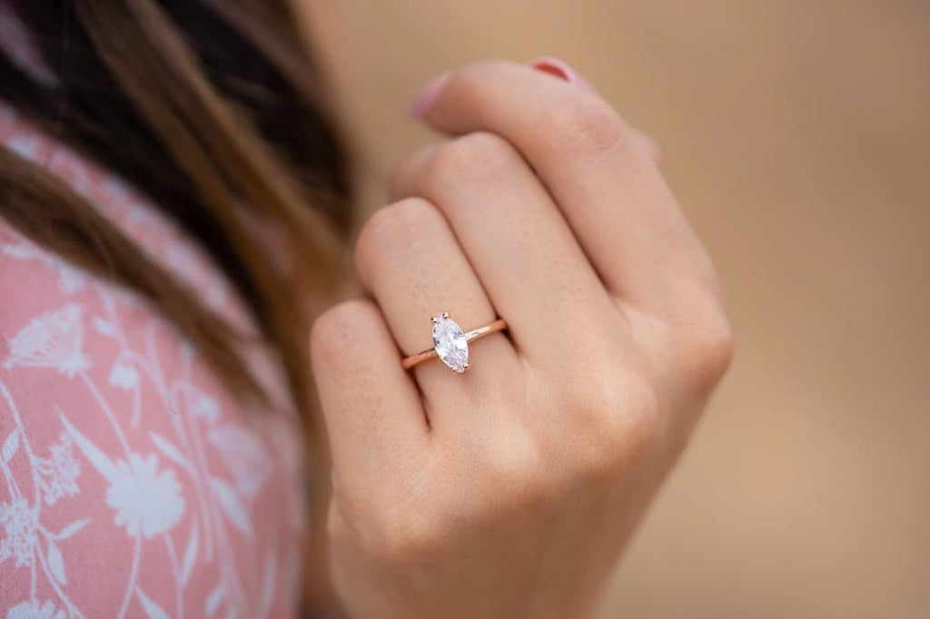 inexpensive conflict free affordable engagement ring rose gold marquise solitaire simple minimal petite