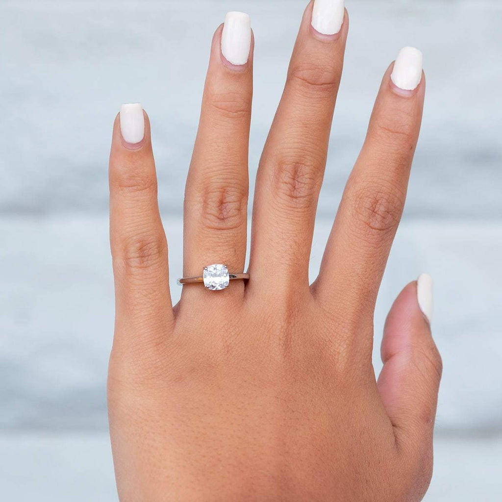 Woman's left hand wearing The Layla on ring finger