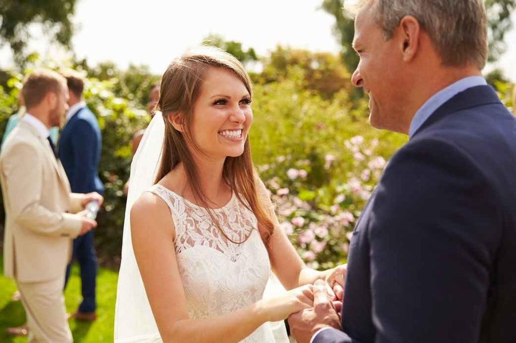 Bride smiling at her father