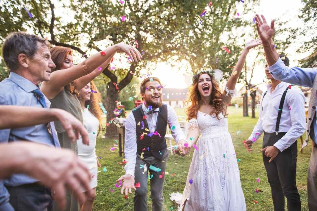 Bride and groom celebrating with wedding party