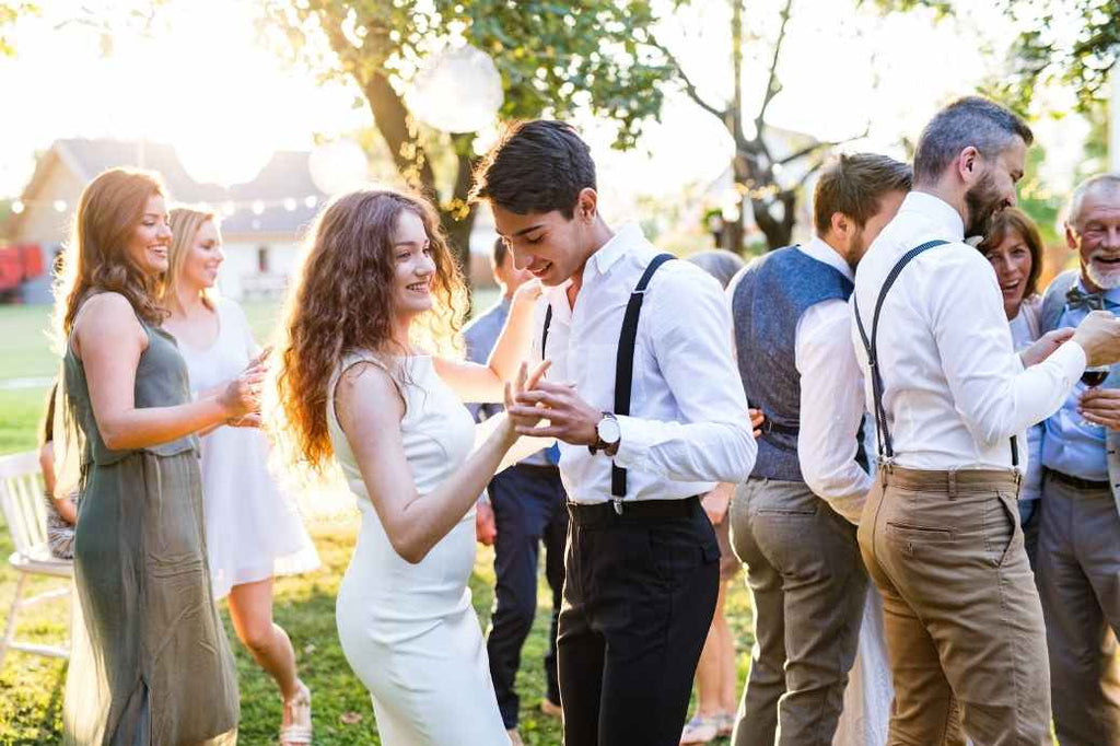 Wedding party and guests dancing