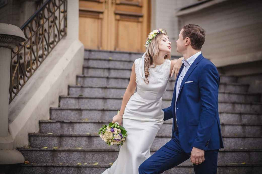 Bride and groom on courthouse steps