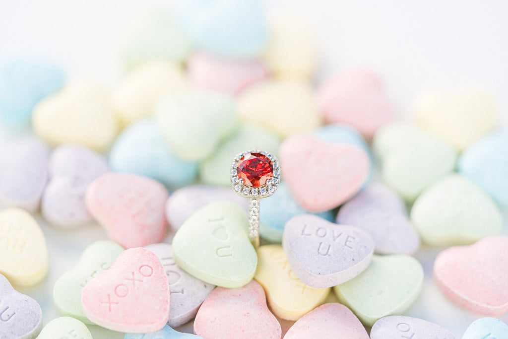 candy hearts and ruby halo engagement ring for affordable and inexpensive valentine's day gifts