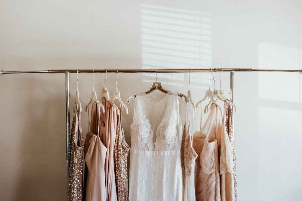 Rack of formal dresses with a wedding dress displayed in the middle