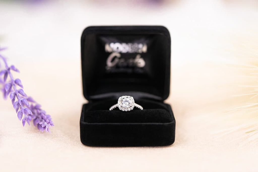 cushion cut halo engagement ring inexpensive affordable conflict free simulated diamond black velvet clamshell ring box