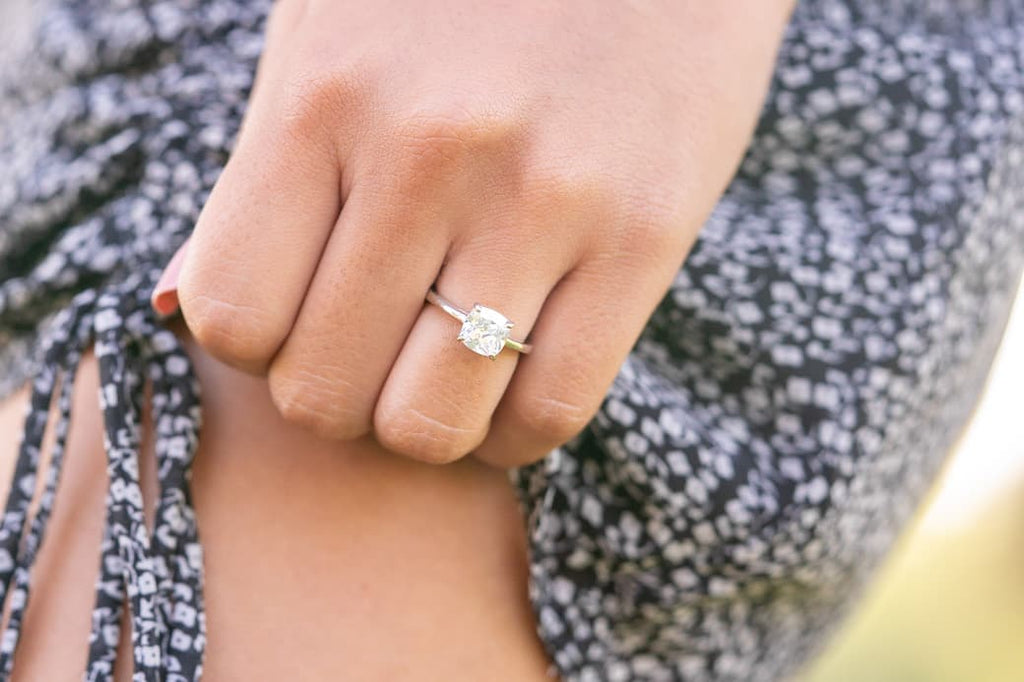 cushion cut solitaire petite 1.25 carat engagement ring simple simulated diamond stone inexpensive affordable conflict free