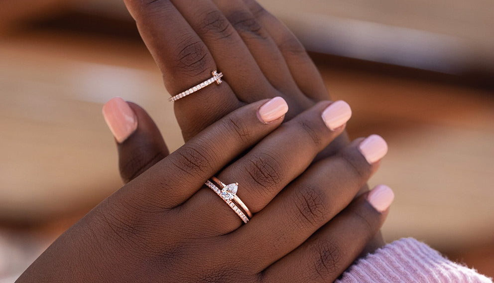dark skinned woman wearing gold and silver rings