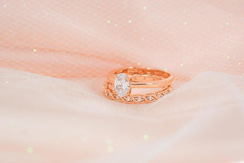 gold oval cut engagement ring and wedding band set