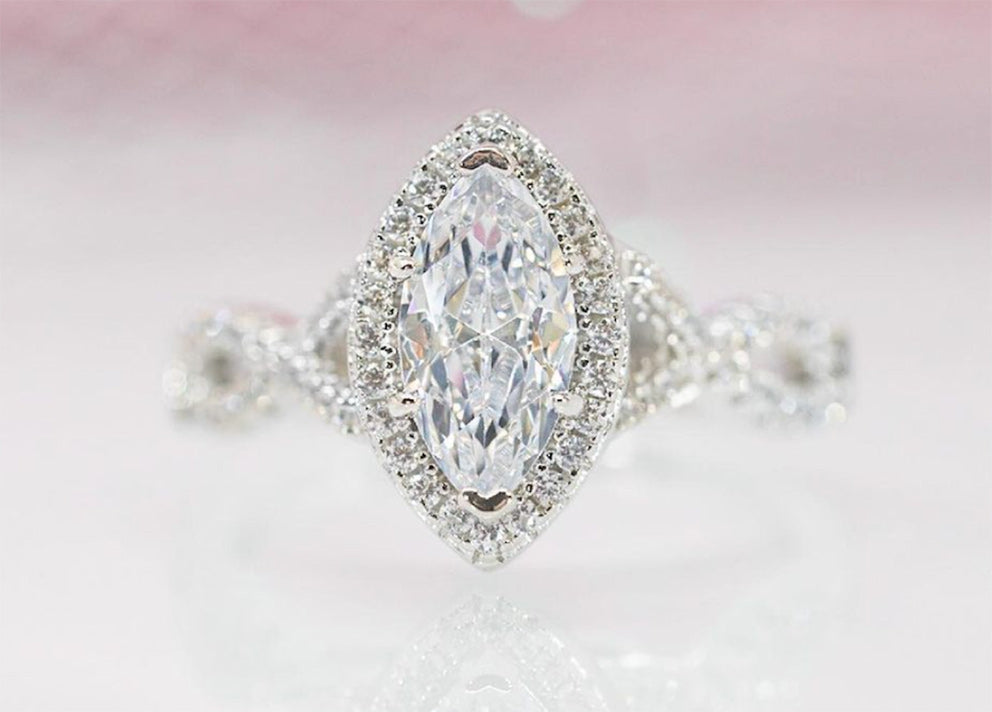 a silver oval cut engagement ring