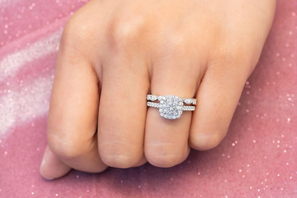a woman wearing a rhodium plated ring