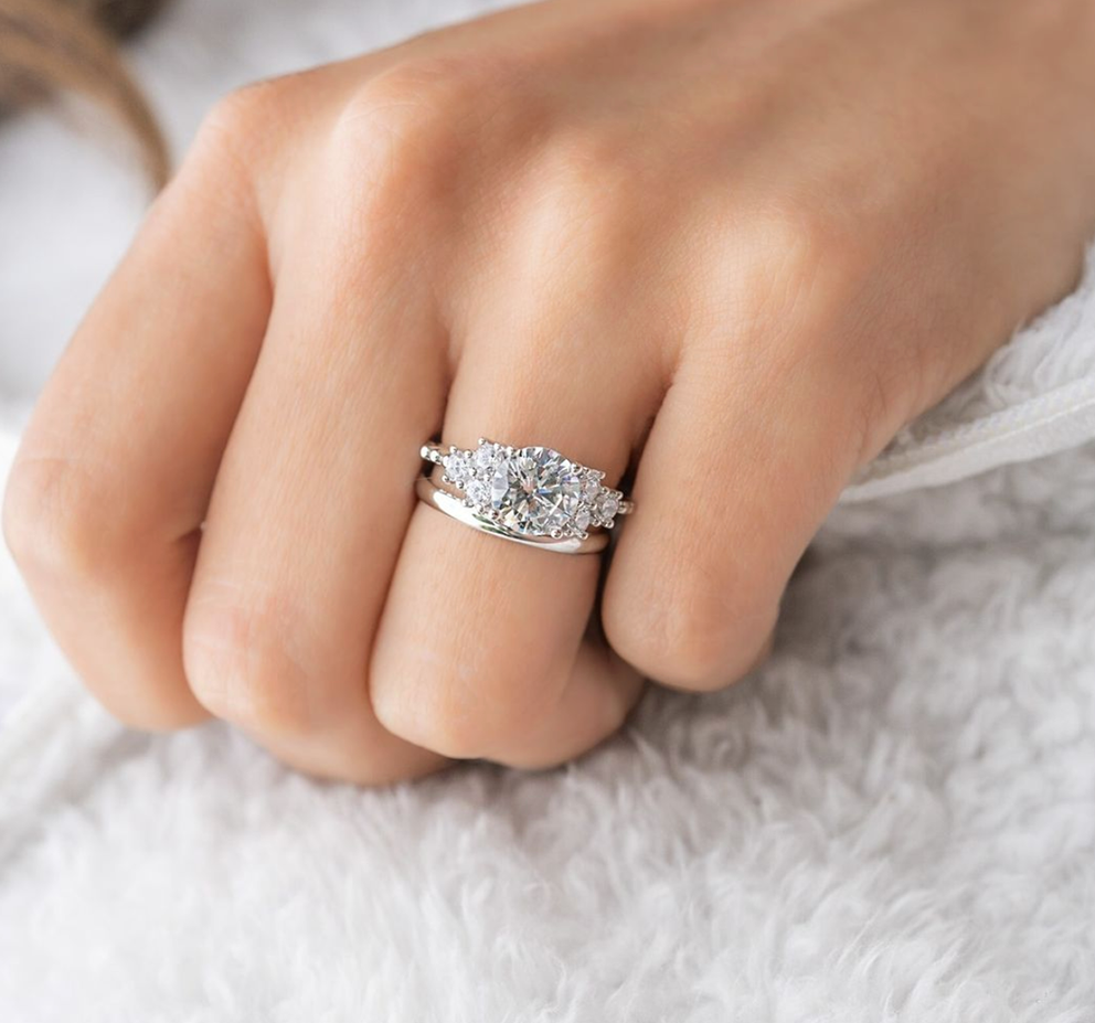 engagement ring with silver wedding band
