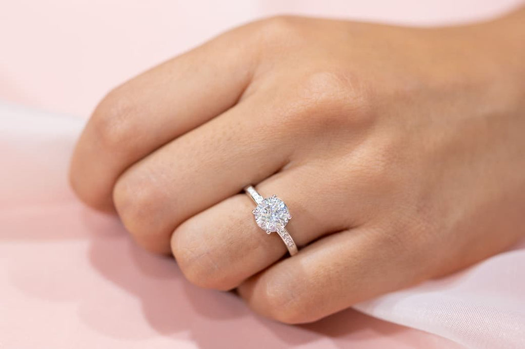 Woman's left hand wearing The Enchanted on ring finger