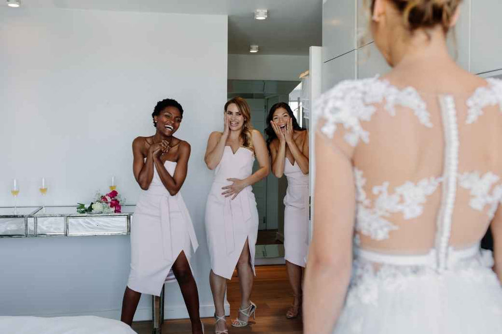 spend time with bridesmaids morning of your wedding checklist bride planning what to do advice tips tricks
