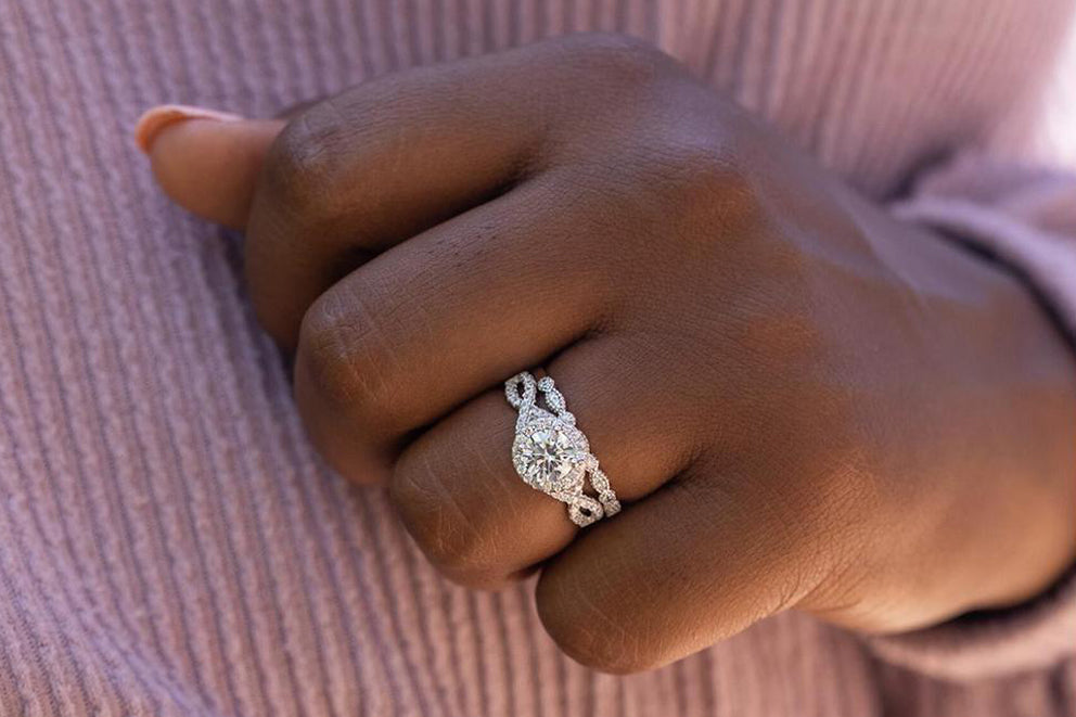 a woman wearing the grace paired with the forever ring