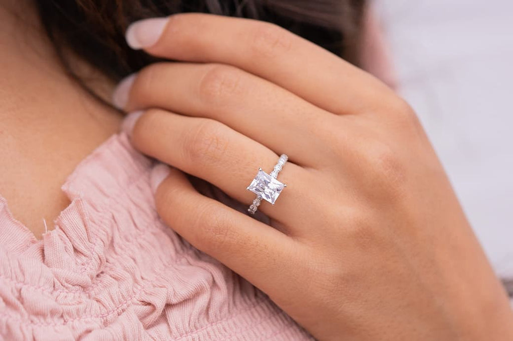Woman's left hand wearing The Alexandria on ring finger