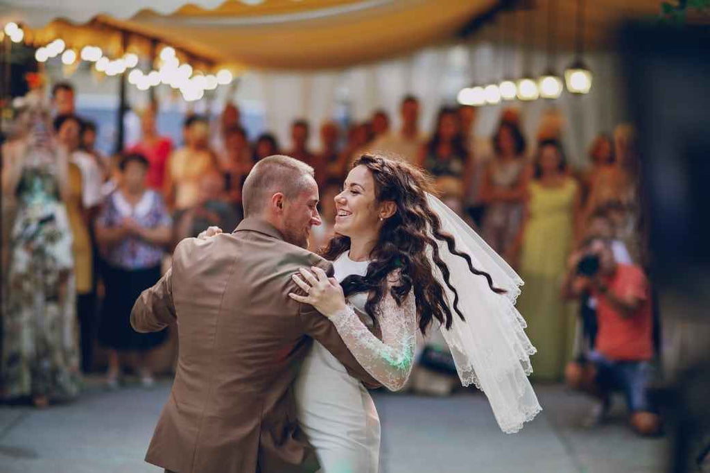 Bride and groom dancing and smiling
