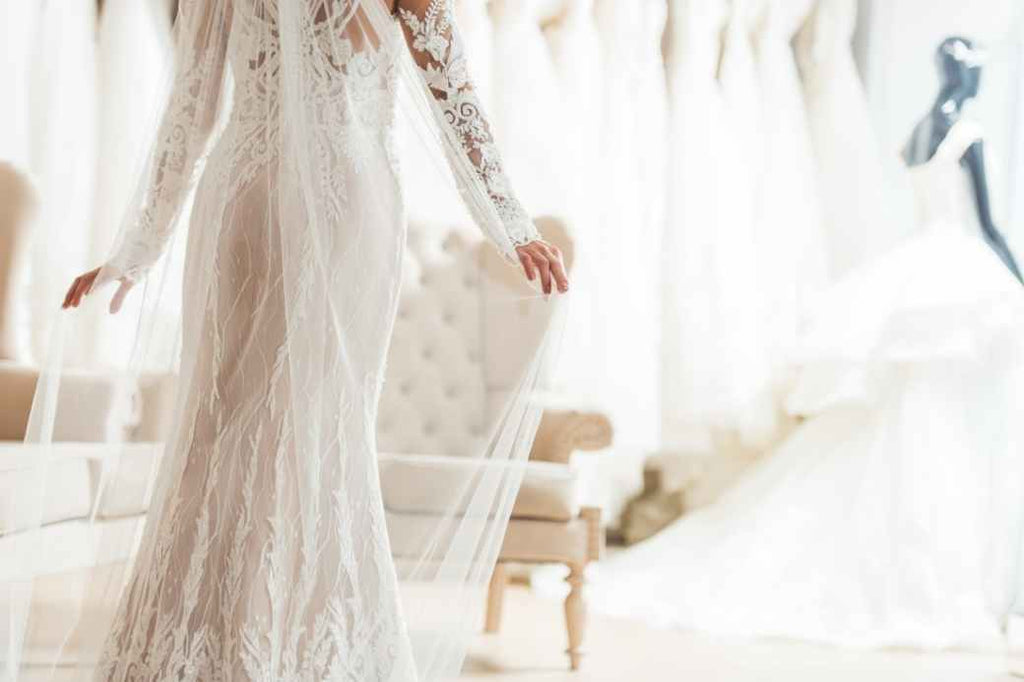 Woman trying on a wedding dress