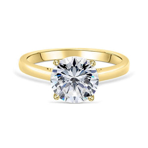 the one and only gold round cut solitaire engagement ring