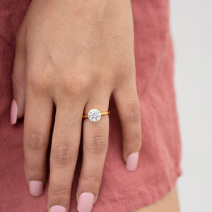 the one and only gold round cut engagement ring