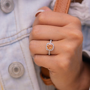 the halo morganite engagement ring on ladies hand