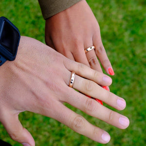couples wearing the infinity wedding ring