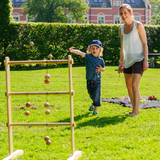 We can see a young family in this image, enjoying Bex's Ladder Game Pro. Great fun on summer afternoons with family and friends, perfect for adults and children of all ages and sporting ability. Available at Novel Idea Online. Free Shipping on all Orders.