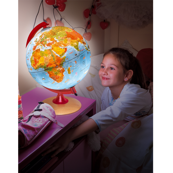 A young girl demonstrating how the Nova Rico, Illuminated Circus Globe looks when Illuminated. It is also being displayed as a bedroom night light. Available at Novel Idea Online. Free Shipping on All Orders. (25cm)