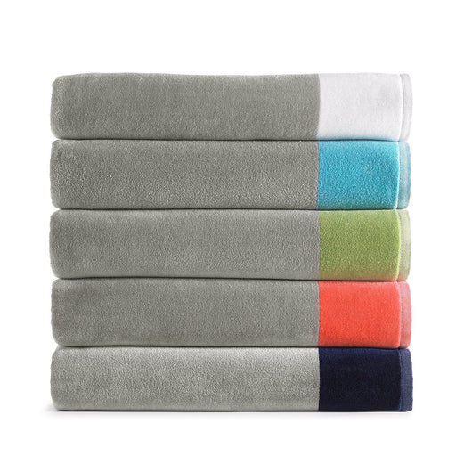 stack of gray beach towels with colored border in white, green, coral, navy, and aqua