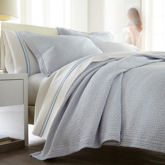 juliet barely blue coverlet on bed white sheets