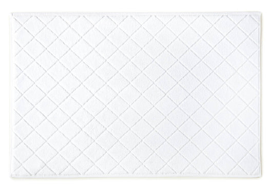 white cotton bath mat with sculpted diamond design