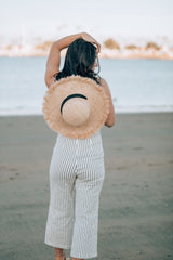Straw hat and jumpsuit
