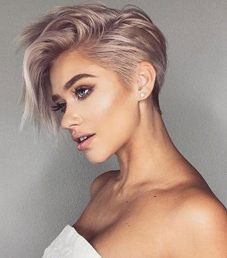 long pixie cut hairstyle blonde looking to the side