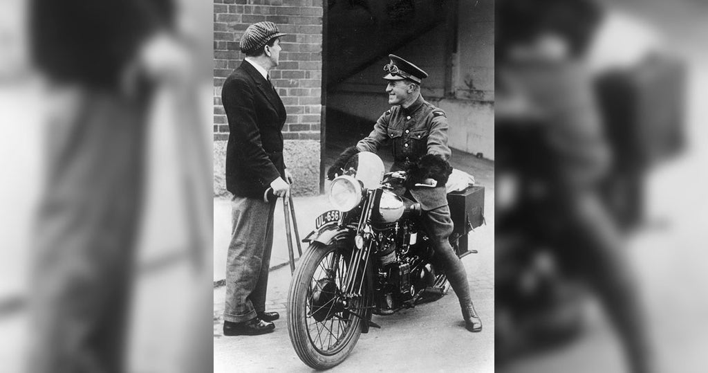 George Brough with crutches after an accident with one of his prototypes, gives Lawrence his brand new SS100 so he can ride it back home for the first time.